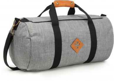 "Revelry Supply The Overnighter Small Duffle The Revelry Supply The Overnighter Small Duffle is Revelry Supply's smallest duffle, great for a weekend trip or your active lifestyle. The Revelry Supply The Overnighter Small Duffle comes in five colors: black, green, crosshatch grey, navy blue, and striped black and is Odor Absorbing and Water Resistant. Revelry Supply The Overnighter Small Duffle Features: Odor absorbing Water resistant Carbon Filter System Rubber-backed nylon Custom protective lining Waterproof zipper Velcro zipper covering Lockable Inner stash pocket Outer side pockets Genuine leather accents Removable shoulder strap Dimensions: 20"" x 11"" x 11"" Volume: 28L Refresh your Revelry Supply The Overnighter Small Duffle by simply placing in the dryer for a few minutes – until warm – to release all absorbed odors."