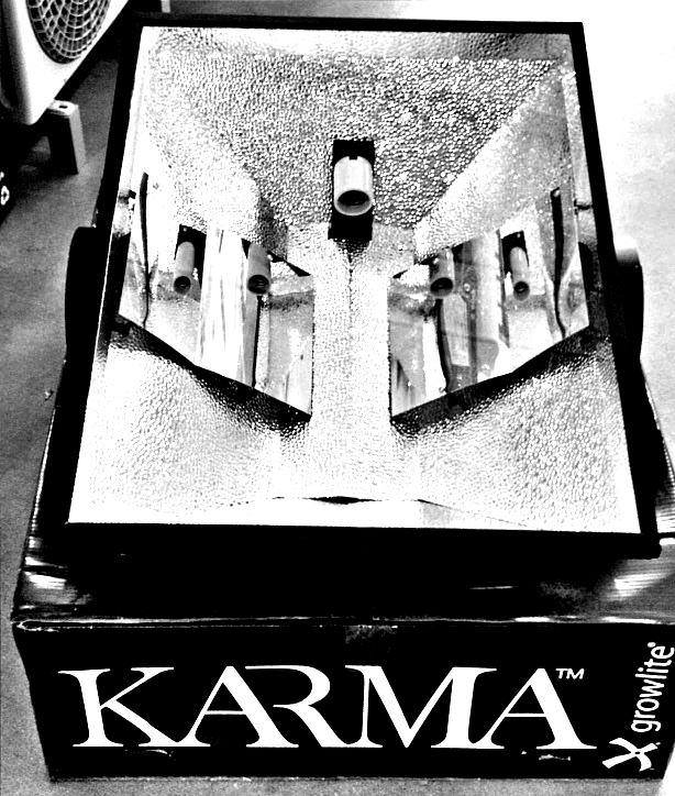 """Karma 8 inch Reflector from GrowLite This item is for pre-sale only. Expected first shipment date is August 2013. The Karma (250w-1000w) 8  Reflector by GrowLite utilizes Growlite's patented CVAT technology to create 100% internal lamp reflectivity. By creating 100% internal lamp reflectivity, Karma is able to redistribute the light spread over your canopy allowing for complete maximized uniform plant growth. Karma,  Our bigger is better.  Give your plants the light they deserve with the Karma 8  Hood. Vertical lamp for even light distribution. Concealed Vacuum Airflow Technology. Black Matte powder coat finish. 8"""" Duct for Airflow / Push or Pull. Removable door for lamp access and easy cleaning. 1/8"""" Thick Tempered Glass. 1 Pair of V-Hooks for mounting Standard with 15ft cord and ballast plug 22 gauge steel MH / HPS Dimensions L33.75""""x W26.50""""xH10"""" OR Flanges included : L33.75""""x W30""""x H10"""