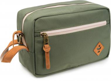 """Revelry Supply The Stowaway Toiletry Kit Revelry Supply The Stowaway Toiletry Kit With lots of pockets and a bit of padding, Revelry Supply The Stowaway Toiletry Kit is perfect for holding all of your travel essentials. The Revelry Supply The Stowaway Toiletry Kit is available in five colors: Black, Green, Navy Blue, Crosshatch Grey, and Striped Black. Odor absorbing Water resistant Carbon Filter System Rubber-backed nylon Custom protective lining Waterproof zipper Lockable Padded Inner divider External zippered pocket Genuine leather accents Metal hardware Dimensions: 11"""" x 6"""" x 5′ Volume: 5L Refresh your Revelry Supply The Stowaway Toiletry bag by simply placing in the dryer for a few minutes – until warm – to release all absorbed odors."""