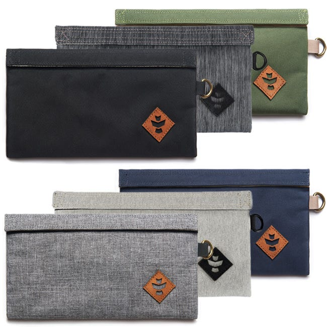 Revelry Supply - The Confidant Small Bag Odor absorbing and water resistant, The Confidant is a smaller, single pocket bag for just the essentials. The Confidant is basic...but in a good way. This double Velcro sealed, single pocket, pouch is ideal for the essentials. Carry it alone or toss it in one of the other Revelry Supply bags. Features Odor absorbing Water resistant Dual carbon filter Silicone backed nylon exterior Custom protective lining Double velcro seal Benefits What sets these bags above the rest is their ability to encapsulate odors, preventing their escape, and to protect against water damage. The key to their high functionality is the custom system of layers used in each bag. The outermost layer is a rubber-backed nylon which is what makes these bags water resistant and also keeps odors contained within the bag. Working your way into the bag, there is a Dual Carbon Filter. These layers work together to filter out any unwanted odors. Lastly, they have a cotton lining. It is soft to the touch and also helps to protect the longevity of the Dual Carbon Filter. What also sets these bags apart is the quality materials; all bags have rubber-coated zippers, genuine leather accents, and metal hardware. Refresh your bag by simply placing in the dryer for a few minutes—until warm—to release all absorbed odors.