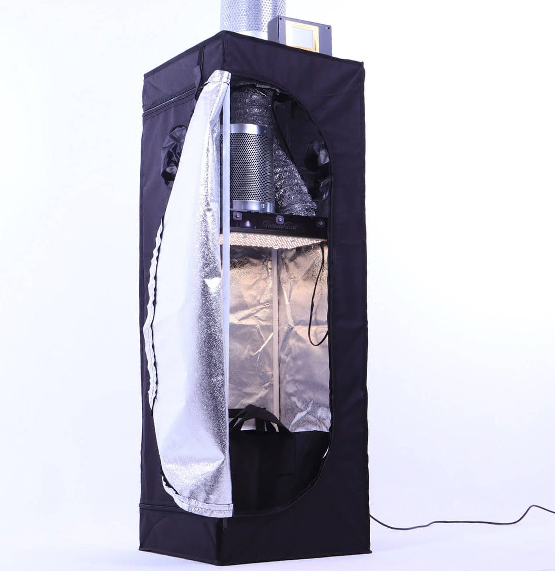 """TomatoTent - Intelligent Mini Grow Tent A small, stealthy Grow Tent with intelligent grow computer that makes sure you succeed. The Computer tells you if the plants need water, and you won't have to check. You won't have to think about temperature and humidity because the computer regulates those within the ideal range. Harvest enough for Yourself and a friend, and don't worry about """"running out"""". Never again get crabby from hours of waiting for that flaky dealer. Grow the Strain for Your needs... Enjoy the Tomatoes right for you… now you are making your own best medicine. Has an oversized Air filter, so it won't Stink up your house. Even unexpected guests (like your in-laws or the alcohol drinking neighbor) won't smell a thing. On top of that, the speed-controlled fan will help the filters work 100 %. (There is activated carbon inside the filter and air moves through them SLOWLY … and the stuff has enough time to work). Very Small Dimensions 1.3 x 1.3 x 4.4 ft.Hide it in a wardrobe or closet and it's out-of-sight. With the 2nd filter on top its 5.25ft high. Pays for itself. Seasoned pro-growers will get 3 ounces (every 3.5 months). If you're a Beginner-Gardener, you won't rake-in that much…. but chances are you score 1/2 ounce to 1 ounce from your first grow....and that means you'd have the investment back after 2, maybe 3 grow cycles (that you can complete over 1 year). Quieter than a fridge. (I measured it). The fan runs as slow as possible to keep the noise down. TomatoTent won't go on your nerves. Uses 120 Watts of Electricity… your power bill goes up about $US 15 per month. (Based on the average power price in the USA). That's not enough to raise suspicions or to cause """"Bill-Shock"""". Effective Samsung LED Grow light… that will produce a good harvest and earn you the respect of """"PRO-GROWERS"""" (who would scoff at cheap LEDs). Actively Air Cooled Grow Lamp. Your plants won't wilt from 'heat-stroke', even if you live in the swamps of Florida or the Arizona desert."""